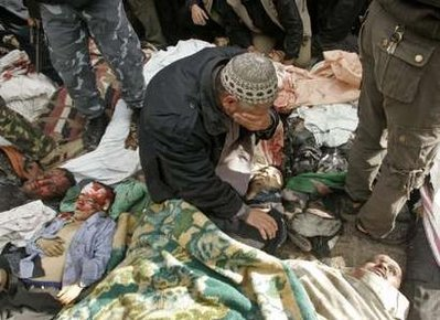 A Palestinian man cries over the body of his son following an Israeli air strike in Gaza December 27, 2008.