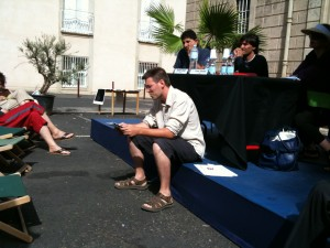 Pierre Soletti reads siting down in the noon heat.