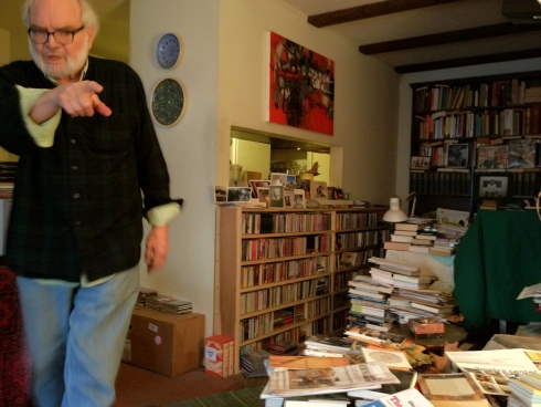 Ken Irby at home in Lawrence, pointing out  a book I'm looking for.